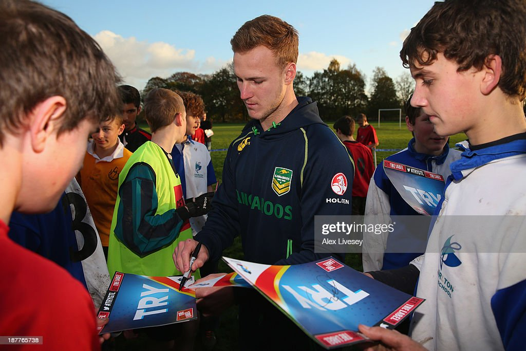 <a gi-track='captionPersonalityLinkClicked' href=/galleries/search?phrase=Daly+Cherry-Evans&family=editorial&specificpeople=7594603 ng-click='$event.stopPropagation()'>Daly Cherry-Evans</a> of Australia signs autographs after giving out coaching tips to school boys from seven different schools to help kick off the Mancunians inaugural Year 10 tournament the largest Rugby League schools event held in the city of Manchester at Parrswood High School on November 12, 2013 in Manchester, England.