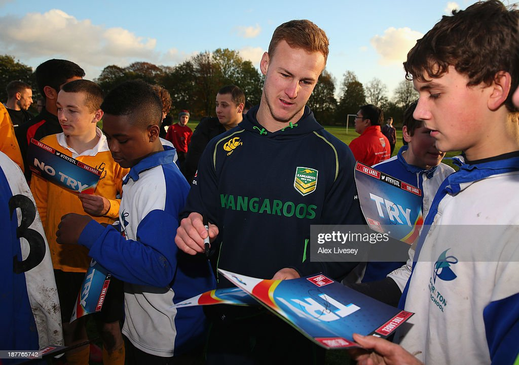 Daly Cherry-Evans of Australia signs autographs after giving out coaching tips to school boys from seven different schools to help kick off the Mancunians inaugural Year 10 tournament the largest Rugby League schools event held in the city of Manchester at Parrswood High School on November 12, 2013 in Manchester, England.