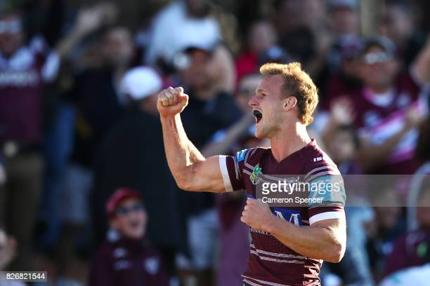 Daly CherryEvans of the Sea Eagles celebrates scoring a try during the round 22 NRL match between the Manly Warringah Sea Eagles and the Sydney...