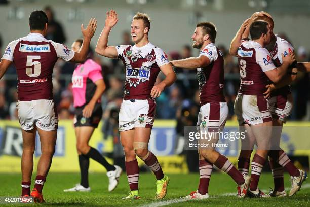 Daly CherryEvans of the Sea Eagles celebrates with team mates after scoring a try during the round 18 NRL match between the ManlyWarringah Sea Eagles...