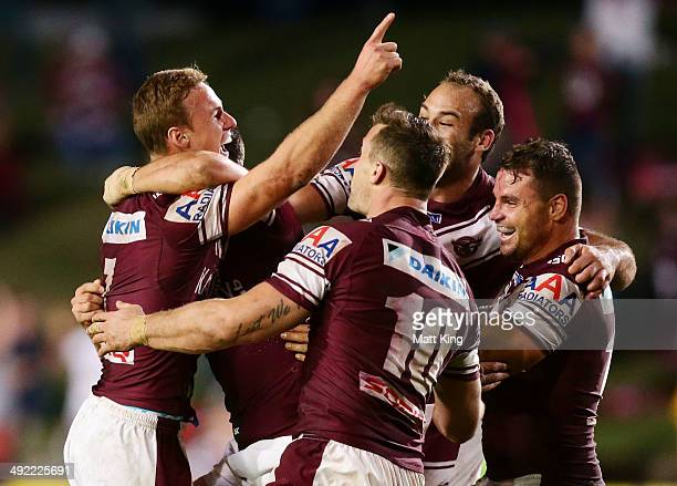 Daly CherryEvans of the Sea Eagles celebrates with team mates after kicking the winning field goal during the round 10 NRL match between the...
