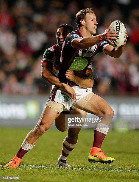 Daly CherryEvans of the Sea Eagles is tackled by Benji Marshall of the Dragons during the round 17 NRL match between the Manly Sea Eagles and the St...