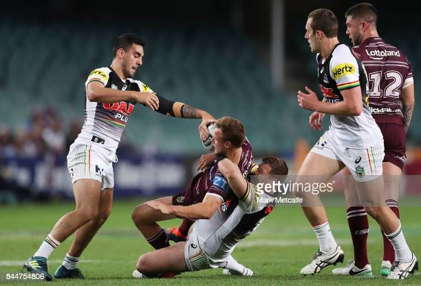 Daly CherryEvans of the Sea Eagles is tackled by Trent Merrin of the Panthers during the NRL Elimination Final match between the Manly Sea Eagles and...