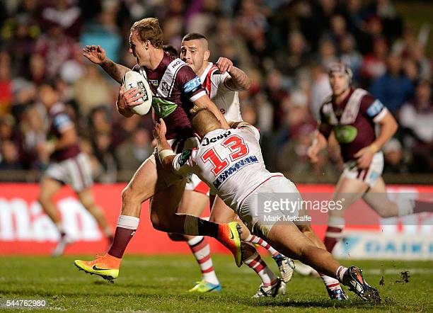 Daly CherryEvans of the Sea Eagles is tackled during the round 17 NRL match between the Manly Sea Eagles and the St George Illawarra Dragons at...