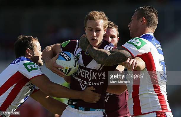 Daly CherryEvans of the Sea Eagles is tackled during the round nine NRL match between the Manly Sea Eagles and the Newcastle Knights at Brookvale...