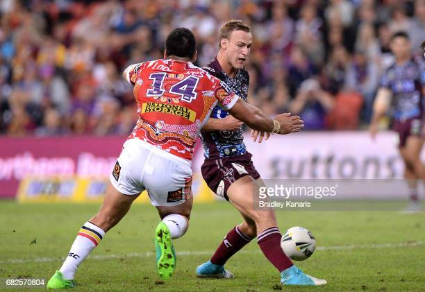 Daly CherryEvans of the Sea Eagles kicks the ball through during the round 10 NRL match between the Manly Sea Eagles and the Brisbane Broncos at...