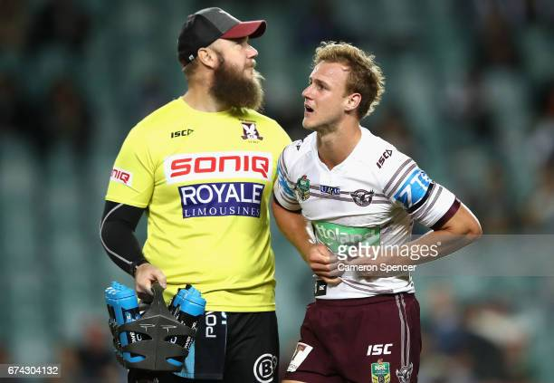 Daly CherryEvans of the Sea Eagles receives attention after being hit late during the round nine NRL match between the South Sydney Rabbitohs and the...