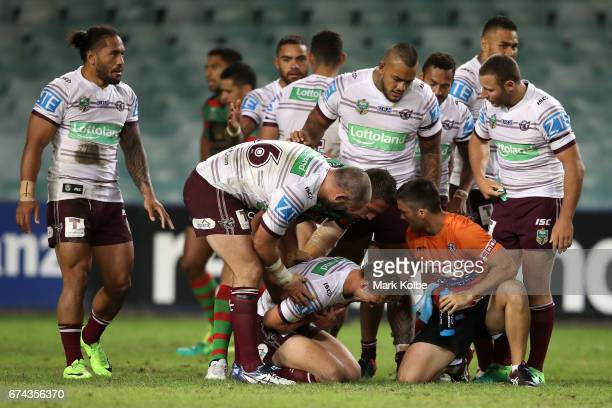 Daly CherryEvans of the Sea Eagles receives treatment after a hit from Sam Burgess of the Rabbitohs during the round nine NRL match between the South...