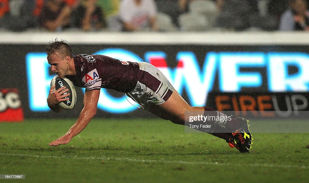 Daly Cherry-Evans of the Sea Eagles scores a try during the round four NRL match between the Manly Sea Eagles and the Wests Tigers at Bluetongue Stadium on March 28, 2013 in Gosford, Australia.