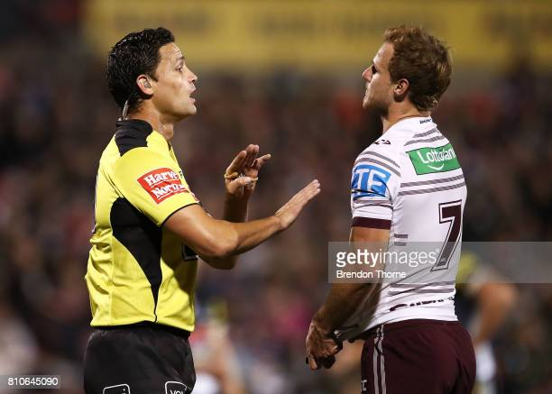 Daly CherryEvans of the Sea Eagles speaks with Referee Henry Perenara during the round 18 NRL match between the Penrith Panthers and the Manly Sea...