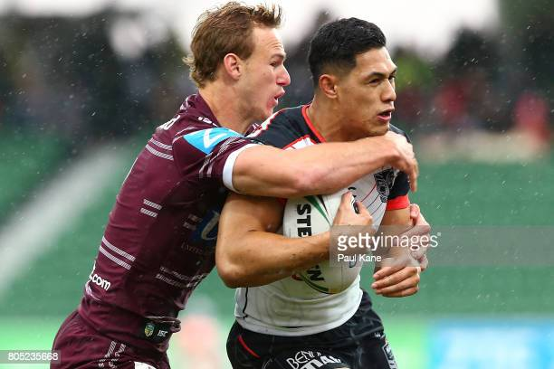 Daly CherryEvans of the Sea Eagles tackles Roger TuivasaSheck of the Warriors during the round 17 NRL match between the Manly Sea Eagles and the New...