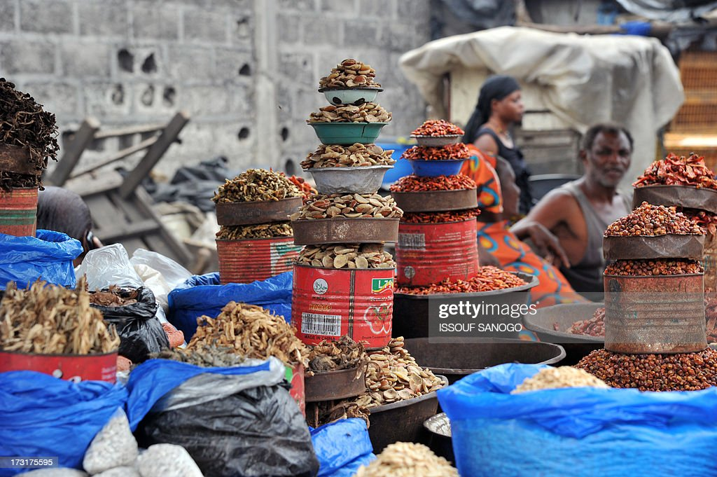 Daly life goes on in the market in Abobo, a suburb of Abidjan, on July 9, 2013, on the first day of the Islamic holy month of Ramadan in Abidjan.