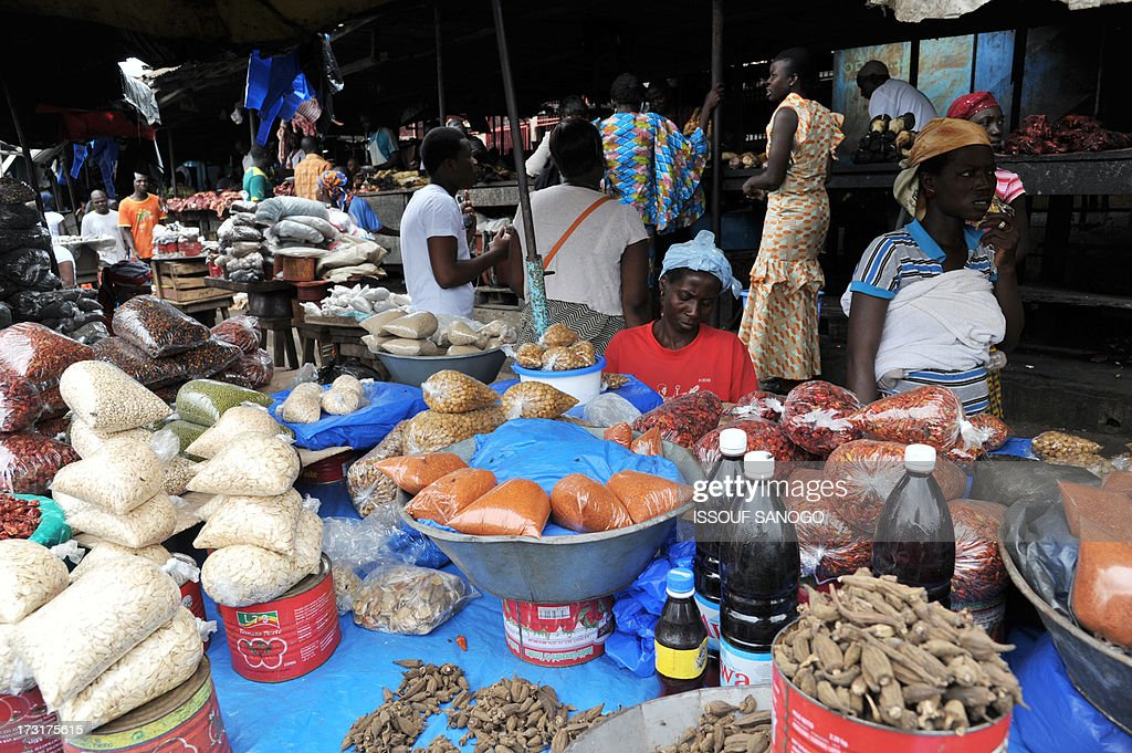 Daly life goes on in the market in Abobo, suburb of Abidja, on July 9, 2013, on the first day of the Islamic holy month of Ramadan in Abidjan.