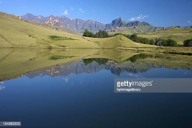 A dam reflecting the Drakensberg mountains, Drakensberg Park, KwaZulu-Natal, South Africa