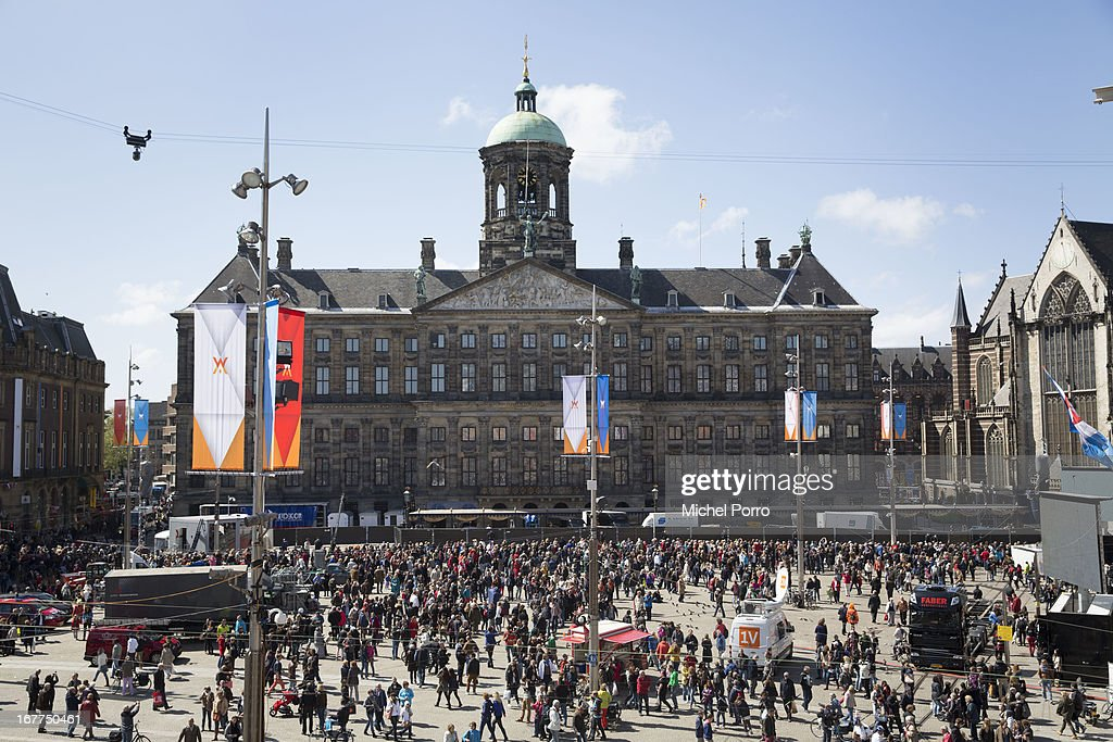 Dam Square with in the background the Royal palace is filling with people one day prior to the coronation of Crown Prince Willem Alexander of The Netherlands on April 29, 2013 in Amsterdam Netherlands.