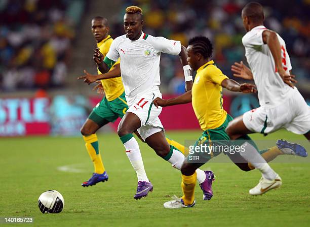 Dama Ndoye of Senegal vies with South African defence during a friendly football match between South Africa and Senegal at the Moses Mabhida Stadium...