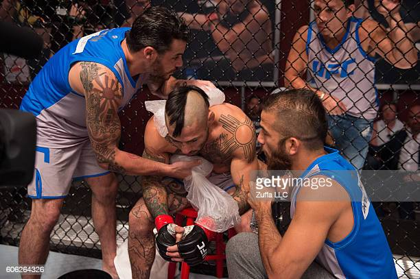 Damacio Page receives advice from his corner inbetween rounds while facing Adam Antolin during the filming of The Ultimate Fighter Team Benavidez vs...