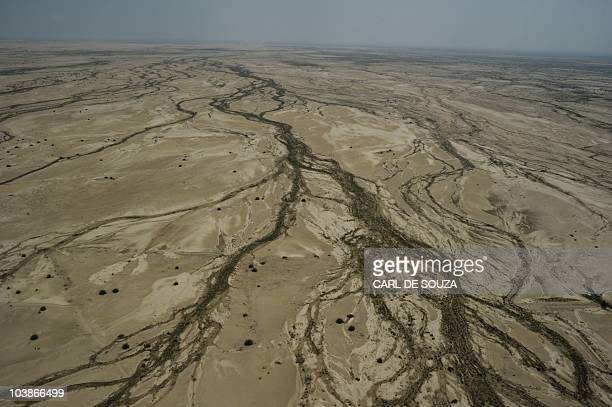 Damage caused to land by flooding in Southern Punjab is pictured in an aerial view from a United Arab Emirates Chinook helicopter delivering aid...
