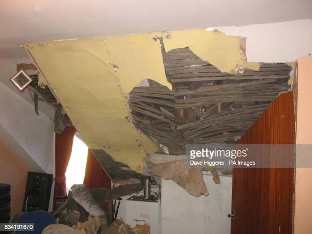 Damage done to the attic of Kleber Afonso's house in Wombwell Barnsley after earthquake with a magnitude of 52 on the Richter scale near Market Rasen...