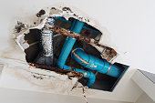 Damage home ceiling in restroom, water leak out from piping system make ceiling damaged