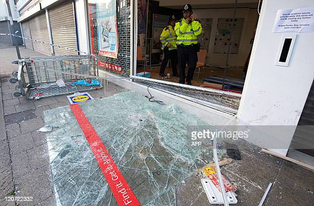 Damage is pictured to the retail store Argos in Croydon south of London on August 9 following a third night of violence on the streets of London...