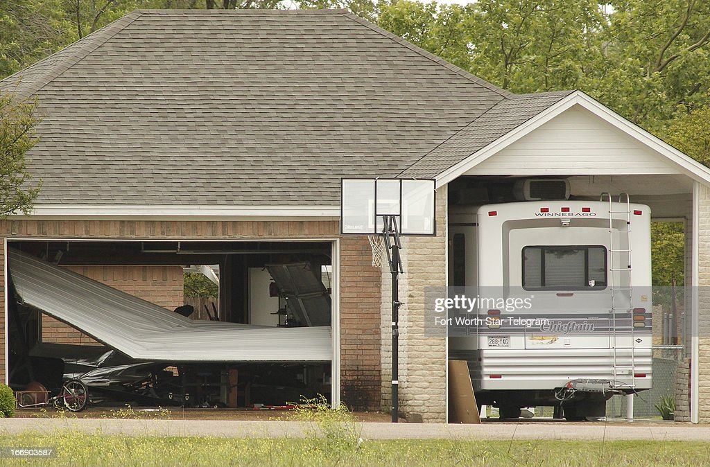 Damage is seen on homes near a fertilizer plant in West, Texas, on Thursday, April 18, 2013. Much of the small town suffered damage when the plant caught fire causing a massive explosion Wednesday night. Authorities are still trying to determine the death and injury toll.