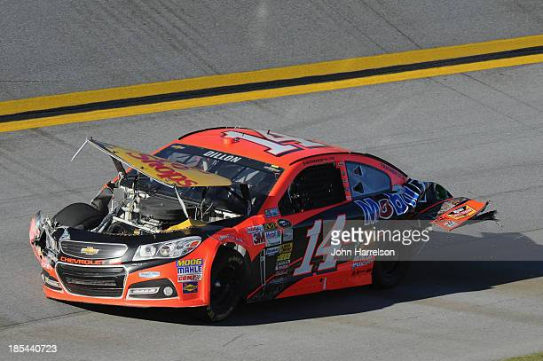 Damage is seen on the car of Austin Dillon driver of the Bass Pro Shops / Mobil 1 Chevrolet after crashing during the NASCAR Sprint Cup Series...