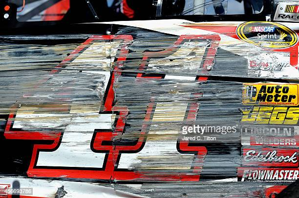 Damage is seen on the car of Kurt Busch driver of the Haas Automation Chevrolet following a crash during the NASCAR Sprint Cup Series Hollywood...