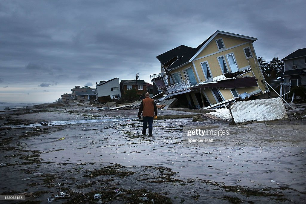 Damage is viewed in the Rockaway neighborhood where the historic boardwalk was washed away during Hurricane Sandy on October 31 2012 in the Queens...