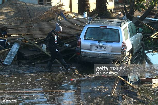 Damage on a street of Concon some 110 km northwest of Santiago on September 17 2015 hit by an earthquake on the eve A powerful 83magnitude earthquake...
