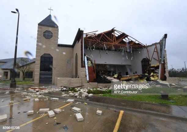 Damage to the First Baptist Church of Rockport after Hurricane Harvey hit Rockport Texas on August 26 2017 / AFP PHOTO / MARK RALSTON