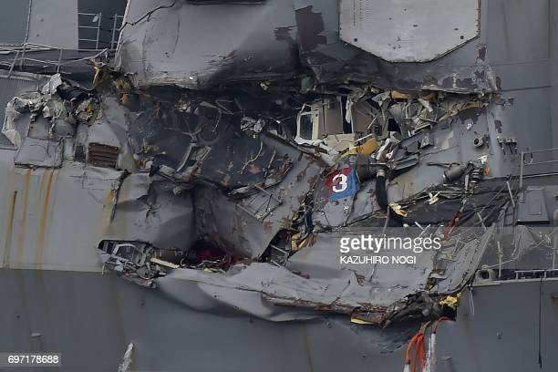Damage to the guided missile destroyer USS Fitzgerald is seen as the vessel is berthed at its mother port in Yokosuka southwest of Tokyo on June 18...