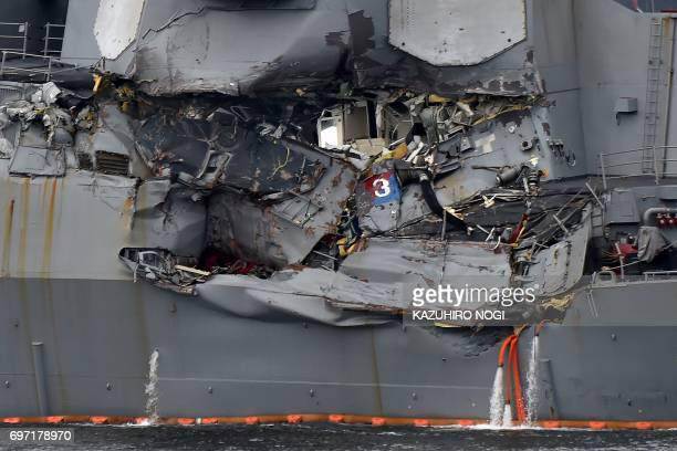 TOPSHOT Damage to the guided missile destroyer USS Fitzgerald is seen as the vessel is berthed at its mother port in Yokosuka southwest of Tokyo on...