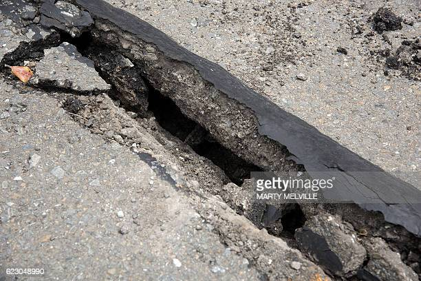 Damage to the road on the Wellington water front after a 78 earthquake centred in the South Island in Wellington on November 14 2016 Rescuers in New...