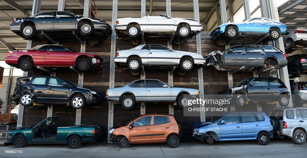 Damaged and used cars are pictured at a hall of a car recovery and recycling company near Munich, southern Germany, on February 6, 2013.
