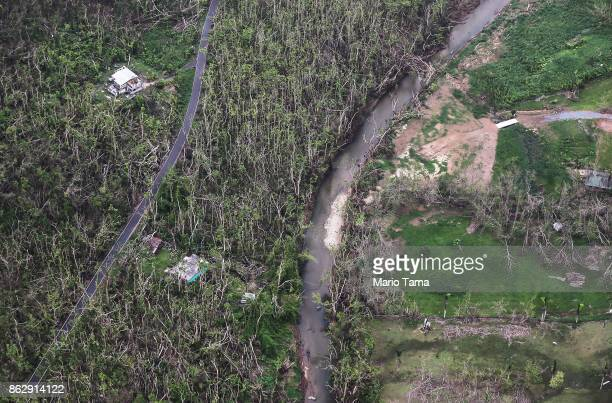 A damaged area is viewed from the air during recovery efforts four weeks after Hurricane Maria struck on October 18 2017 inflight over Puerto Rico...