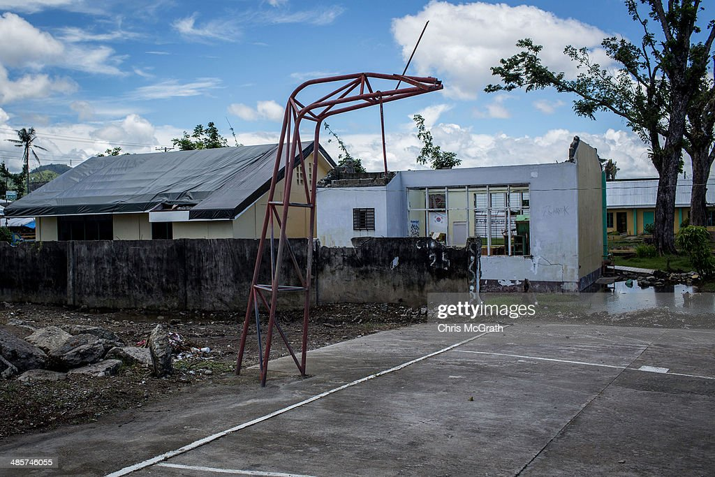 A damaged basketball hoop is seen on April 17, 2014 in Palo, Leyte, Philippines. Basketball is the most popular sport in the Philippines. In the aftermath of Superstorm Yolanda that struck the coast on November 8, 2013 leaving more than 6000 dead and many more homeless, basketball hoops were some of the first things to be repaired and rebuilt amongst the rubble, showing the Filipino's resilience and intense love for the sport. Five months after the storm, basketball courts have re-emerged in large numbers across the damaged provinces using any available space and many being rebuilt from storm debris.