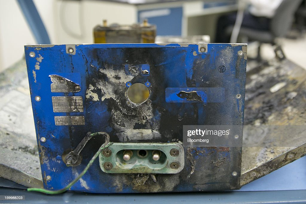 A damaged battery case from a Japan Airlines Co. (JAL) Boeing Co. 787 Dreamliner sits at the National Transportation Safety Board (NTSB) materials laboratory in Washington, D.C., U.S., on Thursday, Jan. 24, 2013. The design of Boeing Co.'s Dreamliner should have prevented battery incidents that prompted regulators to ground the plane on Jan. 7, NTSB Chairman Deborah Hersman said. Photographer: Andrew Harrer/Bloomberg via Getty Images
