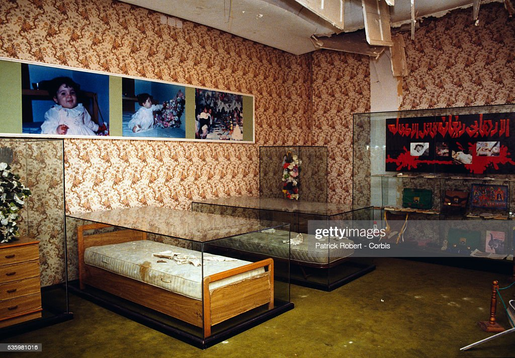 A damaged bedroom on display in Colonel Qadaffi's villa after the American bombings of 1986 with pictures of children killed in the event. In 1986 the United States sought to quell Libya's alleged terrorist activities by bombing several sites in Libya and one of Qadaffi's houses was hit.