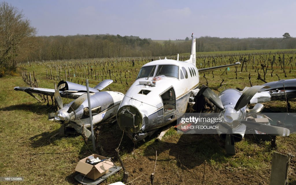 A damaged Beechcraft 90 rests in a vinyard on March 31, 2013 near Sainte-Radegonde in France's south west after the pilot was forced to land among the vines following a mechanical problem after mid-day on March 29.. The pilot and passenger who were travelling back to their Dordogne base walked away from the accident.