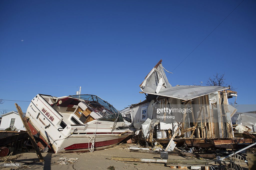 "A damaged boat sits outside a destroyed mobile home in the Paradise Park trailer park in Highlands, New Jersey, U.S. on Saturday, Nov. 3, 2012. Recovery progressed slowly in New Jersey, where Hurricane Sandy struck on Oct. 29. New Jersey Governor Chris Christie, a Republican, praised the ""patience and resilience"" of New Jerseyans and released a timeline Saturday of which neighborhoods without electricity should be restored over the next few days. Photograph: Victor J. Blue/Bloomberg via Getty Images"