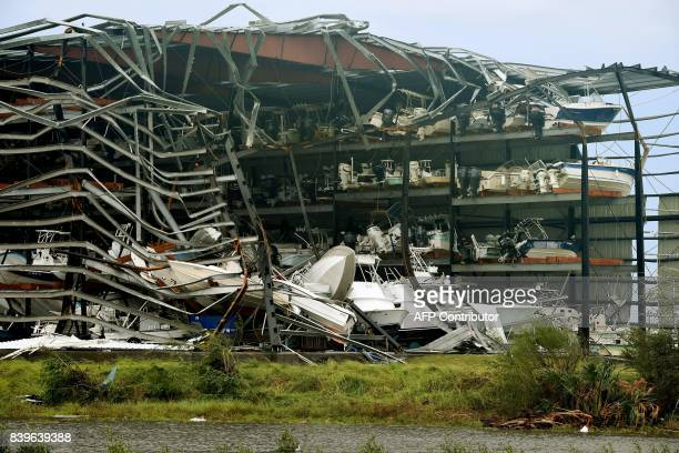 TOPSHOT Damaged boats in a multilevel storage facility are seen following passage of Hurricane Harvey at Rockport Texas on August 26 2017 / AFP PHOTO...