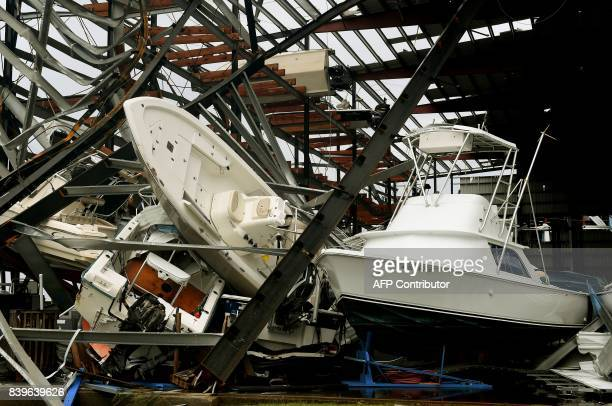 Damaged boats in a multilevel storage facility are seen following passage of Hurricane Harvey at Rockport Texas on August 26 2017 / AFP PHOTO / MARK...