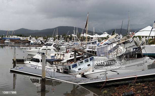 Damaged boats litter a waterfront in Cardwell on February 4 2011 Smashed yachts lay stacked like matchwood near a marina while the ruined husk of a...