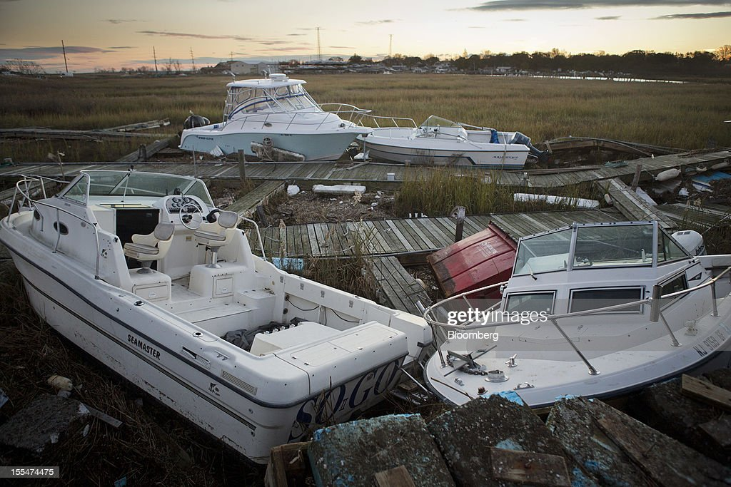 "Damaged boats sit in a marsh after a marina was destroyed during Hurricane Sandy near Keyport, New Jersey, U.S., on Saturday Nov. 3, 2012. Recovery progressed slowly in New Jersey, where Hurricane Sandy struck on Oct. 29. New Jersey Governor Chris Christie, a Republican, praised the ""patience and resilience"" of New Jerseyans and released a timeline Saturday of which neighborhoods without electricity should be restored over the next few days. Photograph: Victor J. Blue/Bloomberg via Getty Images"