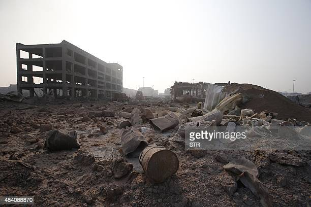Damaged buckets are seen at the site of the explosions in Tianjin on August 15 2015 Residents near the site of two giant explosions in the northern...