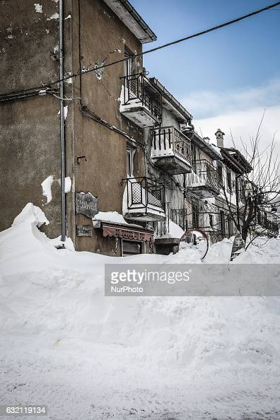 A damaged building in Campotosto Italy on January 19 2017 A great deal of snow has fallen in the area which was hit by four quakes on Wednesday Four...
