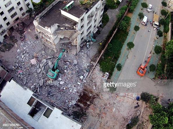 A damaged building is seen a day after a series of blasts in Liucheng county in Liuzhou south China's Guangxi province on October 1 2015 Seven people...