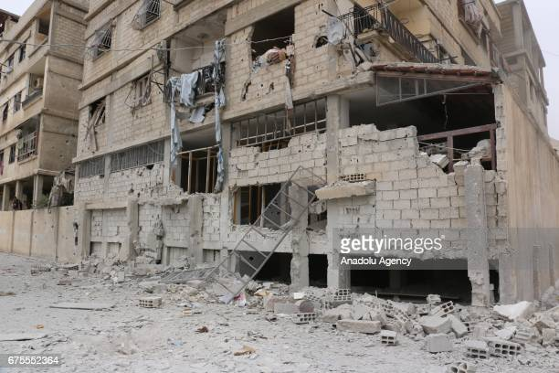 A damaged building is seen after Assad Regime's airstrike hit residential areas at the Saqba town of Eastern Ghouta in Damascus Syria on May 1 2017