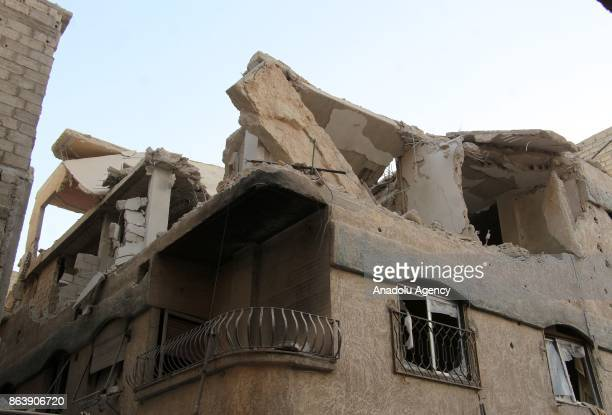 Damaged building is seen after Assad regime's airstrikes hit residential areas of the deconflict zone in Kafr Batna town of Eastern Ghouta of...